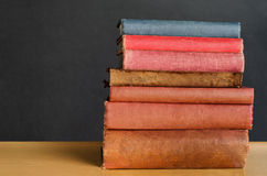 Books Stacked on Classroom Desk Royalty Free Stock Photos