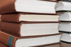 Books stacked. Forefront of a group of books stacked Stock Photos
