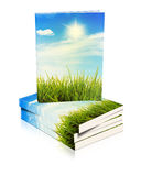 Books stacked on top of each other with nature sce Royalty Free Stock Image