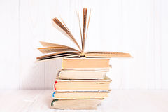 Books stacked on white wooden  background Royalty Free Stock Photo