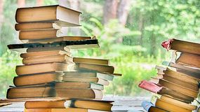 Books are stacked on the windowsill royalty free stock photography