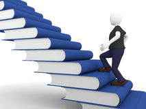 Books stair. A man acquires knowledge over a ladder made of books Royalty Free Stock Images