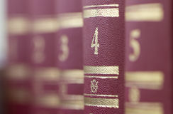 Books standing in a row on a shelf.  Shallow depth of field Stock Photo