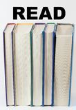 Books Standing Vertically with read over them Stock Images