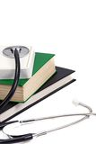 Books and stethoscope on white Royalty Free Stock Images