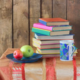 Books. Still life with books, apples  and a cup. Back to school Royalty Free Stock Image