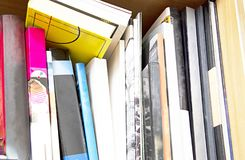 Books stored on the shelf. These days are ideal for reading Royalty Free Stock Photos