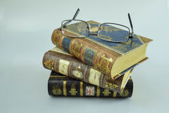Books on a summer day. Three books and glasses on a white background Stock Image