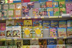 Books on the supermarket shelves Royalty Free Stock Images