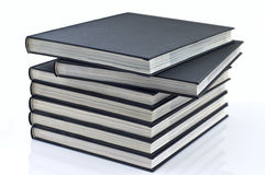 Books on the table. Pile books on the white table royalty free stock photography