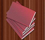 Books on the table. Group of red books isolated on brown background royalty free illustration
