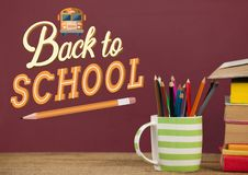 Books on the table against red blackboard with back to school illustration. Digital composite of Books on the table against red blackboard with back to school Royalty Free Stock Image