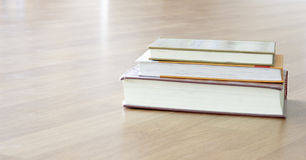 Books on table. Books on brown wooden table Royalty Free Stock Image