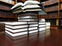 Books on table in libary for studying education and learning royalty free stock images