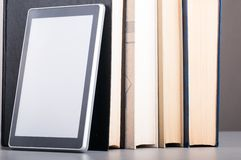 Books and tablet Royalty Free Stock Images