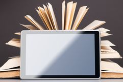 Books and tablet Stock Photos