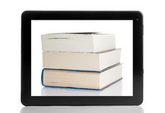 Books and tablet computer  on white background Stock Photography
