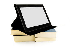 Books and a tablet device Royalty Free Stock Photo