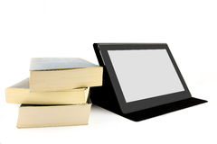 Books and a tablet device Stock Photos