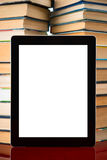 Books and tablet pc Stock Photos