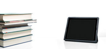 Books and tablet PC on a desktop. Many books and a tablet PC on a desktop stock photos