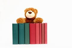 Books and teddy bear Stock Images