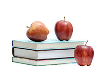 Books and three red apples Royalty Free Stock Photos