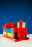 Books tied up with ribbon and e-book reader Stock Photos