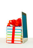 Books tied up with ribbon and tablet PC Royalty Free Stock Photos