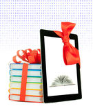 Books tied up with ribbon and tablet PC Stock Photography