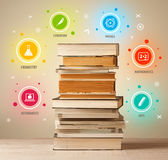 Books on top with colorful symbols on vintage background Royalty Free Stock Photo