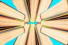 Books top view on a blue background stock photo