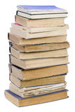 Books tower. The tower of the old retro shabby torn unwanted books isolated stock images