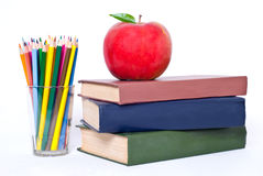 Books tower with apple. Books tower with red apple isolated on white stock image