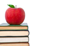 Books tower with apple. Books tower with red apple isolated on white royalty free stock photography