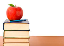 Books tower with apple Royalty Free Stock Photo