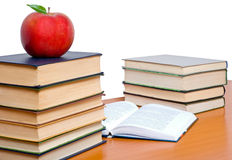 Books tower with apple. Books tower with red apple isolated on white royalty free stock photos