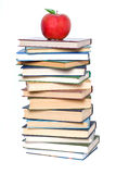 Books tower with apple Stock Photo