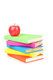 Books tower with apple isolated on white. Background Royalty Free Stock Photography