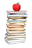 Books tower with apple isolated on white. School and Education. Books tower with apple isolated on white royalty free stock photography