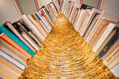 Books tower with endless tunnel of knowledge in the Library Stock Image