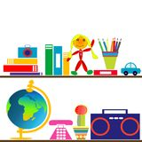 Books and toys on shelves Royalty Free Stock Images
