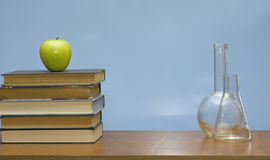 Books and tubes on the desk. Stock Photo