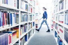 Books at a university library stock photos