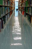 Books at a University Library. Education Image of an Aisle of a University Library stock image