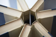 Books in unusual pattern Stock Photos
