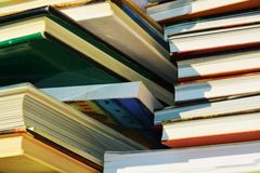 Books of various sizes, knowledge concept, close up Stock Photos