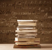 Books on vintage background with math formulas Royalty Free Stock Images
