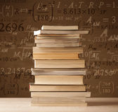 Books on vintage background with math formulas Royalty Free Stock Photo