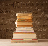 Books on vintage background with math formulas Royalty Free Stock Photography